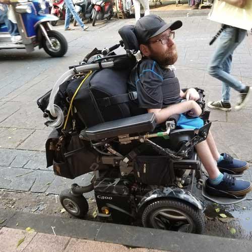 Ean wheeling down Khaosan Road in Bangkok