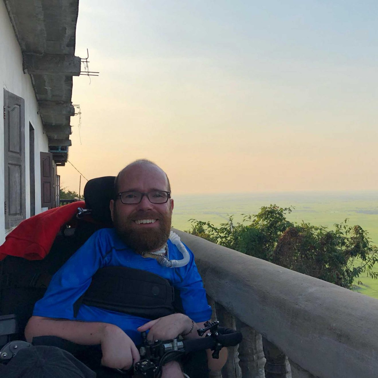 Ean enjoying the view from his hotel's balcony in Cambodia