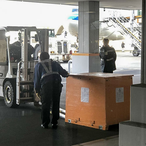 The Powerwheelchair Being Unloaded From Plane